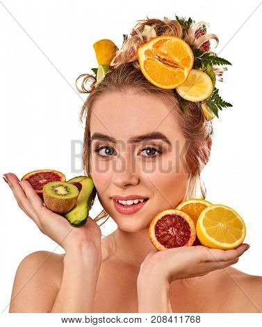 Hair mask from fresh fruits on woman head. Girl with beautiful face hold kiwi and grapefruit for homemade organic skin and hair therapy. Concept of healthy and beauty hair. Acceleration of hair growth