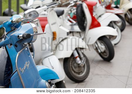STOCKHOLM SWEDEN - SEPT 02 2017: Many parked old fashioned vespa scooters in different colors at the Mods vs Rockers event at the Saint Eriks bridge Stockholm Sweden September 02 2017