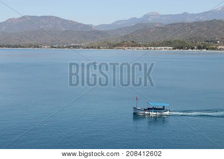 28TH JULY 2017: A motorboat in the calm waters at calis,Fethiye in Turkey ,28th July 2017