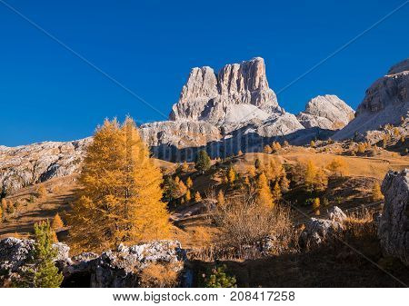 Incredible view from top of Falzarego pass with Cinque Torri peak on background. Colorful autumn morning in Dolomite Alps Cortina d'Ampezzo location Italy Europe.