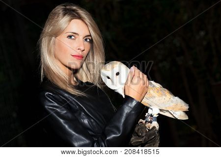 Beautiful Blond Girl Caresses A Barn Owls