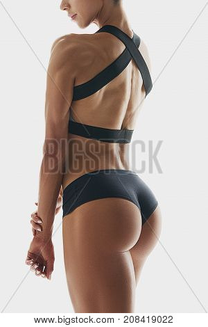 Muscular Young Woman Athletes Back