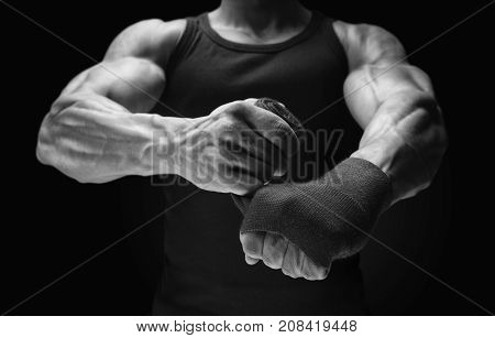 Close-up Photo Of Strong Man Wrap Hands On Black Background Man Is Wrapping Hands With Boxing Wraps