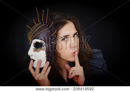 brunette girl holds a beautiful carnival mask