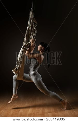 Young Woman Practicing Aerial Yoga Hammock