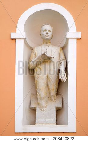 VARAZDIN, CROATIA - JULY 09: Blessed Ivan Merz statue on facade of cahedral of Assumption in Varazdin, Croatia on July 09, 2016.
