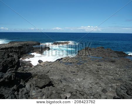 Great view on hardened volcanic lava in Indian ocean