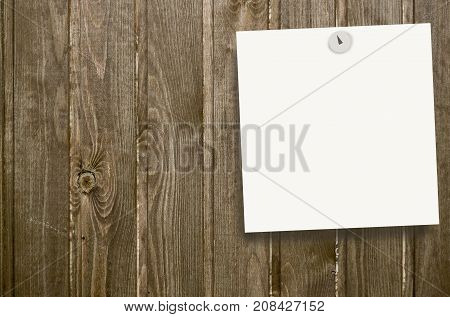 Place for writing (sticky note) pinned to a wooden wall