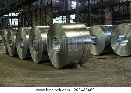 Raw steel coils ready for production in the steel mill