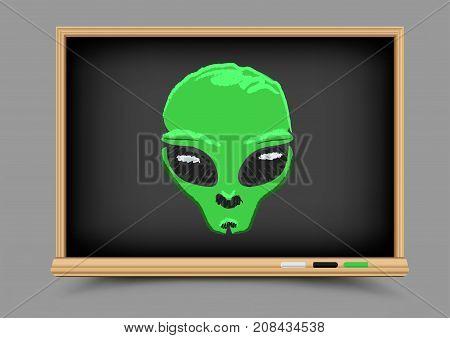 Blackboard Drawing alien with black eyes picture. Educatoin chalk drawing UFO