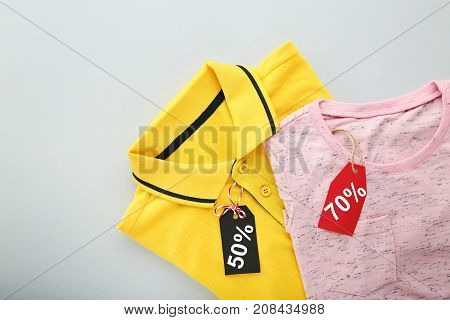 Sale Tags With New Clothes On Grey Background