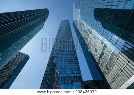Modern Business Skyscrapers, High-rise Buildings, Architecture Raising To The Sky, Sun. Concepts Of
