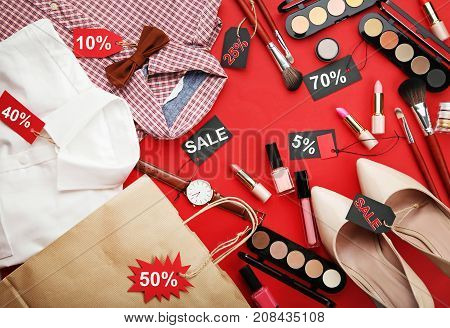 Different Makeup Cosmetics With Sale Tags And New Clothes