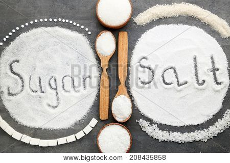 Inscription Sugar And Salt On Grey Wooden Table