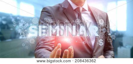 Businessman Showing The Word A Seminar