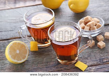 Cup Of Tea With Teabag And Lemon On Wooden Table