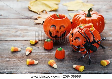 Halloween candies on the brown wooden table