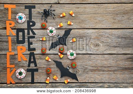 Halloween Candy Corns With Bats And Spider On Wooden Table