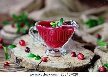 cranberry sauce on a stump with fresh berries