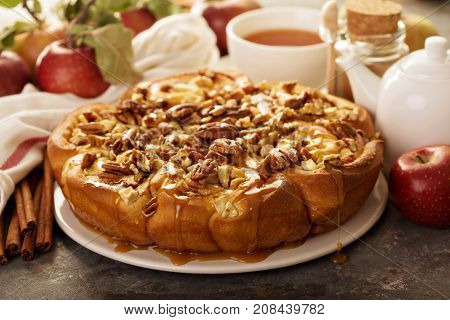 Cinnamon rolls with apples, caramel and pecan, fall baking concept
