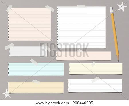 White and colorful striped paper, copybook, notebook sheets for note or message stuck with sticky, adhesive tape, stars and pencil on brown background