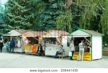 Street vendors sells to tourists homemade products in wooden huts. Novi Sad, Serbia. October - 05, 2017. Editorial image.