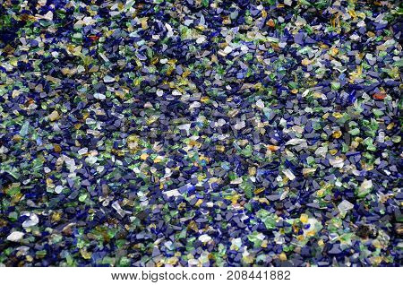Background of colored crushed glass or spun glass for mosaic