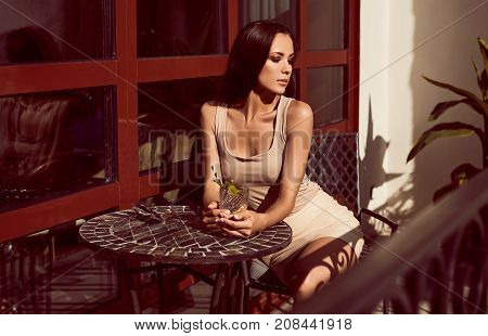 Gorgeous Latin Women In Fashion Dress Drinking Cocktail In The Restaurant