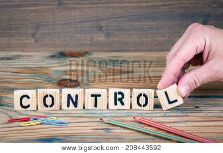 control. Wooden letters on the office desk. Business and communication background.