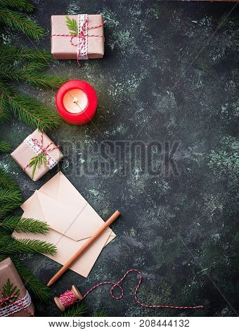 Christmas background. Gift boxes, letter and candle. Top view