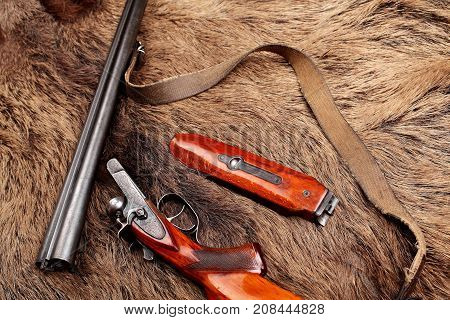 Old Double-barreled Shotgun, Disassembled, Gun On Wild Boar Furs.top View. Copy Space