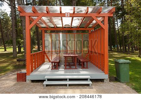 picnic house at the campsite with wooden table and bench