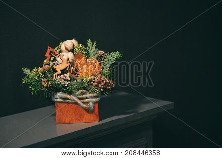 Christmas floral composition. a New Year's bouquet with a deer. in dark tones background