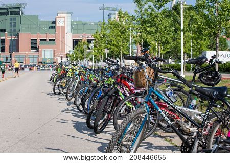 Green Bay WI - August 1 2017: Bicycles lined up near Lambeau Field placed there by local kids who hope a Packer player will ride their bike from the practice field to the stadium. The community owned Packers encourage interactions between players and fans