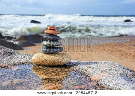Zen Balancing Pebbles on ocean background, Harmony and Balance