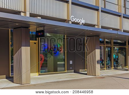 Zurich, Switzerland - 11 October, 2017: entrance to the office of the Google company on Gustav Gull square. Google is a multinational technology company specializing in Internet-related services and products, founded by Larry Page and Sergey Brin.