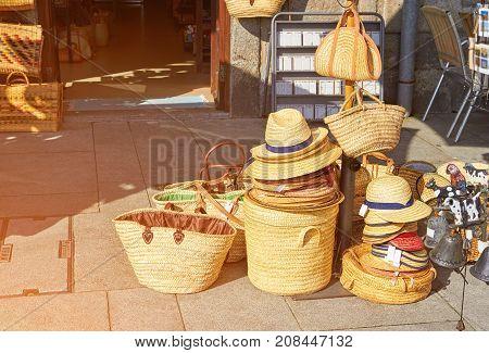 Straw bags in street Shop in Porto, Portugal