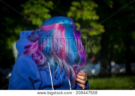 Girl with extreme hair colour: pink, purple, blue