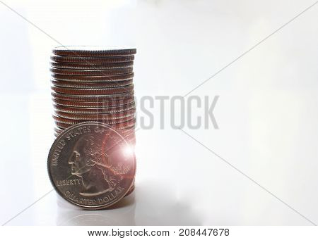 dollar a lot of coins arranged on a white background business idea.