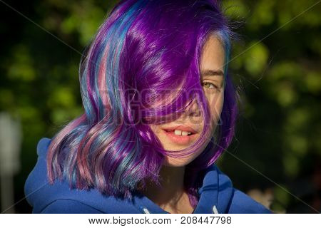 Girl with extreme hair on a green background