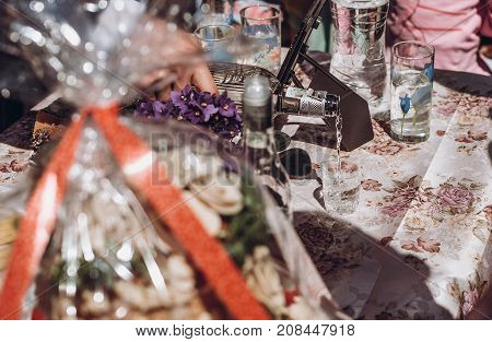 Man Pouring Vodka In Glass On The Table With Meat Snacks. Wedding Reception Outdoors. Feast. Holiday
