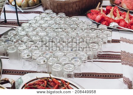 Many Vodka Glasses  On Beer Table At Wedding Reception In Restaurant. Luxury Catering. Christmas Cel