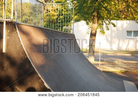 Springboard for skaters in the autumn park. Close-up. A view from the side. The concept is sport.