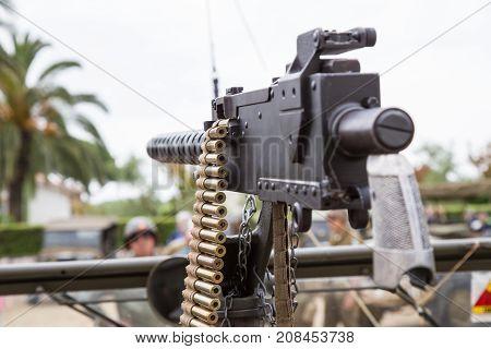 Machine gun mounted on a military vehicle