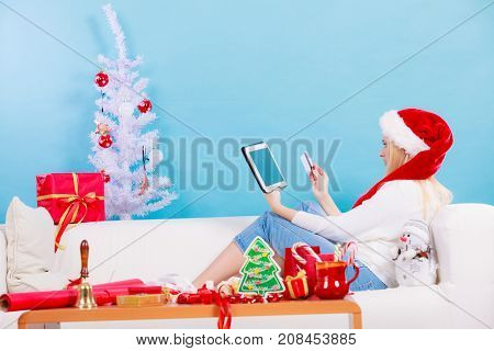Girl With Tablet Credit Card Doing Online Shopping