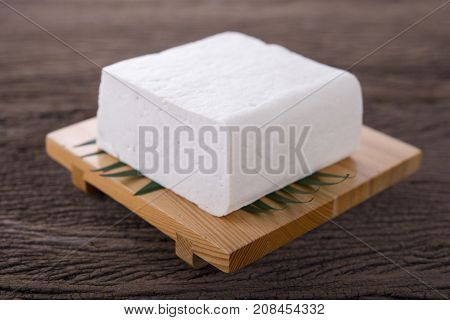 square tofu on plate and on wooden background