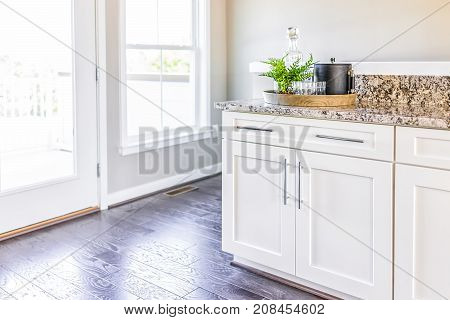 Modern Clean Wet Bar With Granite Countertop Cabinets, Serving Tray And Door To Balcony In Staging O