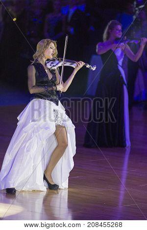 Minsk Belarus-October 7 2017: Palladium Electric Band Female Violinist Elena Polyakova Performing on WDSF International Capital Cup MinskOctober 72017 MinskBelarus.