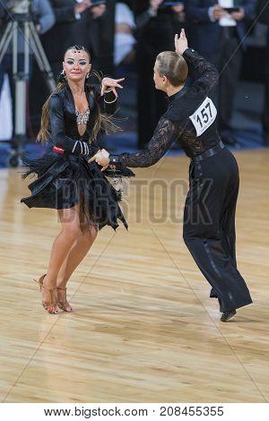 Minsk Belarus-October 7 2017: Dance Couple Of Shevchenko Elisei and Gnutova Alisa Performs Youth-2 Latin-American Program on WDSF International Capital Cup MinskOctober 72017 MinskBelarus.