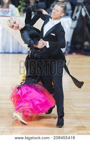 Minsk Belarus-October 7 2017: Dance Couple of Gordeev Ilia and Komarova Daria Performs Adults European Standard Program on WDSF International Capital Cup Minsk- 2017 in October 7 2017 in Minsk Belarus.